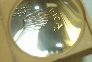 Coin magnifying lens